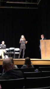 A student making a presentation on a stage