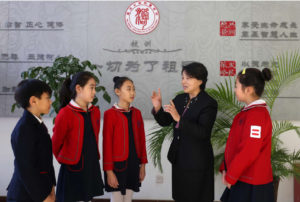 Four Chinese students talking with a Chinese woman
