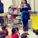 a children's author talks with students